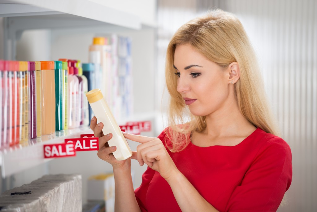 woman checking product label