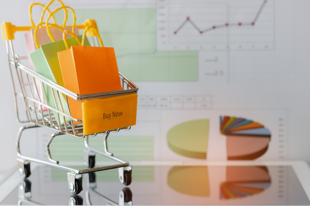 shopping cart with shopping bags