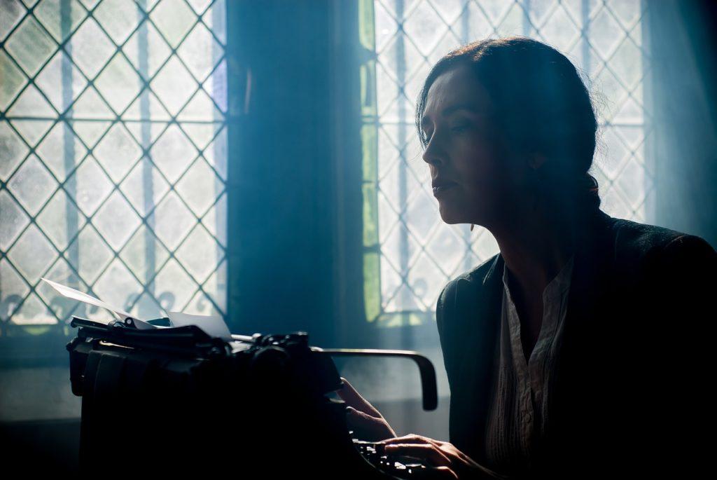 writer using a typewriter
